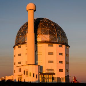 A dramatic exterior of Southern African Large Telescope at sunset.