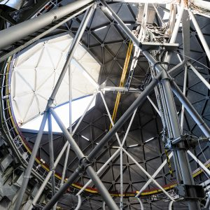 A broad view of the interior of Southern African Large Telescope, the shutter is partway open.