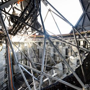 A broader view of the interior of Southern African Large Telescope, showing an open shutter with light entering.