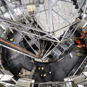 Interior shot of the Southern Africa Large Telescope from above, looking down showing a structure of struts.